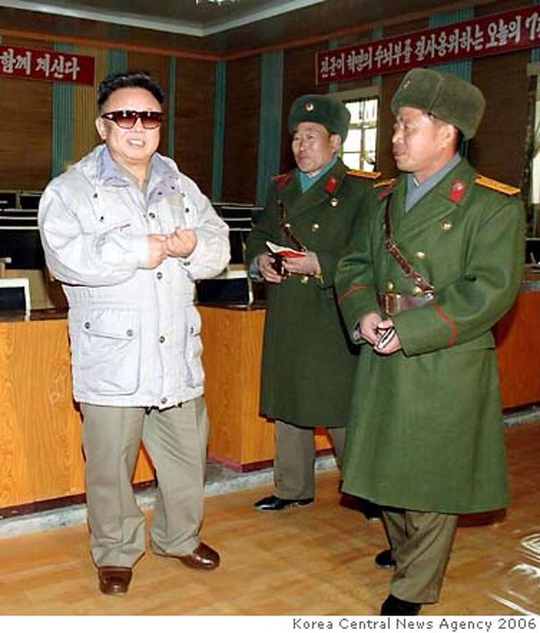 Kim Jong Il (left) so dominates North Korea that his demise could leave a power vacuum even more dangerous than his rule. Korea Central News Agency file photo, 2006