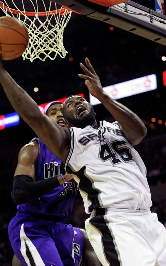 DeJuan Blair goes to the board with a shot against Jason Thompson as the Spurs lose to Sacramento  88-86 at the AT&T Center in San Antonio on January 20, 2012 Tom Reel/ San Antonio Express-News Photo: TOM REEL, Express-News / © 2012 San Antonio Express-News  MAGS OUT; TV OUT; NO SALES; SAN ANTONIO OUT; AP MEMBERS ONLY; MANDATORY CREDIT; EFE OUT