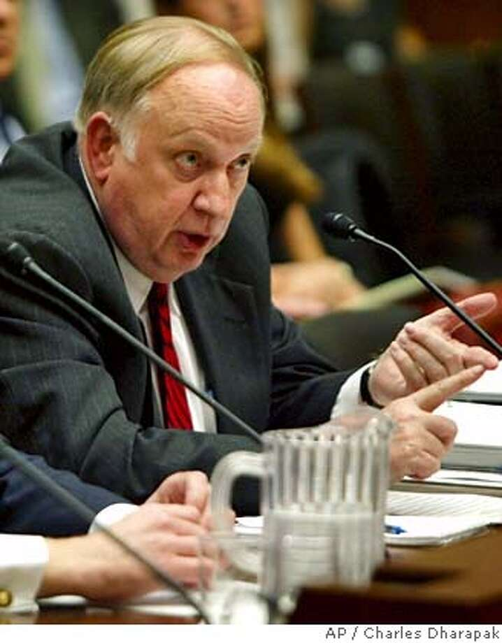 ** FILE ** Linton Brooks, right, undersecretary for nuclear security from the National Nuclear Security Administration, testifies during the hearing of the House Committee on Energy and Commerce's subcommittee on Oversight and Investigation on Capitol Hill in Washington Thursday, May 1, 2003. Energy Secretary Samuel Bodman on Thursday Jan. 4, 2007 announced the dismissal of Brooks, the head of the country's nuclear weapons program because of security breakdowns at weapons facilities including the Los Alamos laboratory in New Mexico. Brooks is to submit his resignation as chief of the National Nuclear Security Administration this month, the department said. (AP Photo/Charles Dharapak) Photo: CHARLES DHARAPAK