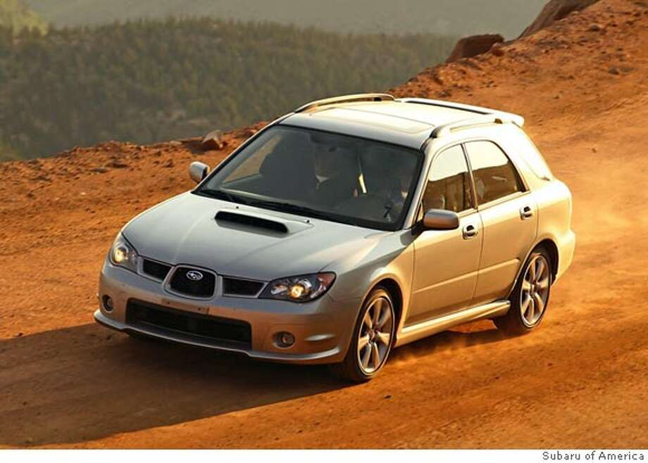 The all-wheel-drive Subaru Impreza WRX Sport Wagon can perform. Yes, it's ugly, but not offensively. Illustrates WHEELS-SUBARU (category l), by Warren Brown � 2006, The Washington Post. Moved Friday, Dec.29, 2006. (MUST CREDIT: Subaru of America.)  Ran on: 01-05-2007 Ran on: 01-05-2007 Ran on: 01-05-2007 Ran on: 01-05-2007 Photo: HANDOUT