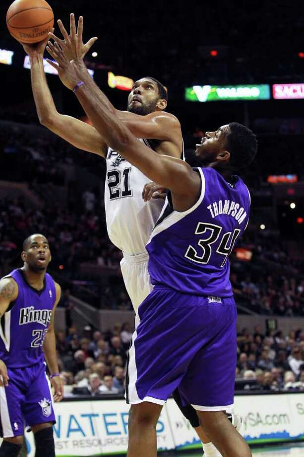 Tim Duncan shoots around Jason Thompson in the first half as the Spurs play Sacramento at the AT&T Center in San Antonio on January 20, 2012 Tom Reel/ San Antonio Express-News Photo: TOM REEL, Express-News / © 2012 San Antonio Express-News  MAGS OUT; TV OUT; NO SALES; SAN ANTONIO OUT; AP MEMBERS ONLY; MANDATORY CREDIT; EFE OUT