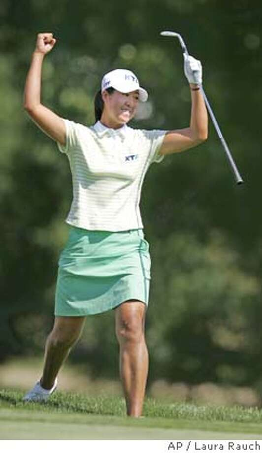 South Korean Birdie Kim celebates after hitting the ball into the hole on 18 from the trap for a birdie to win the US Women's Open at Cherry Hills Village, Colo., on Sunday, June 26, 2005. (AP Photo/Laura Rauch) Photo: LAURA RAUCH