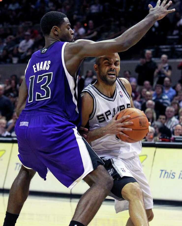 Tony Parker is pressure under the basket by Tyreke Evans as the Spurs play Sacramento at the AT&T Center in San Antonio on January 20, 2012 Tom Reel/ San Antonio Express-News Photo: TOM REEL, Express-News / © 2012 San Antonio Express-News  MAGS OUT; TV OUT; NO SALES; SAN ANTONIO OUT; AP MEMBERS ONLY; MANDATORY CREDIT; EFE OUT