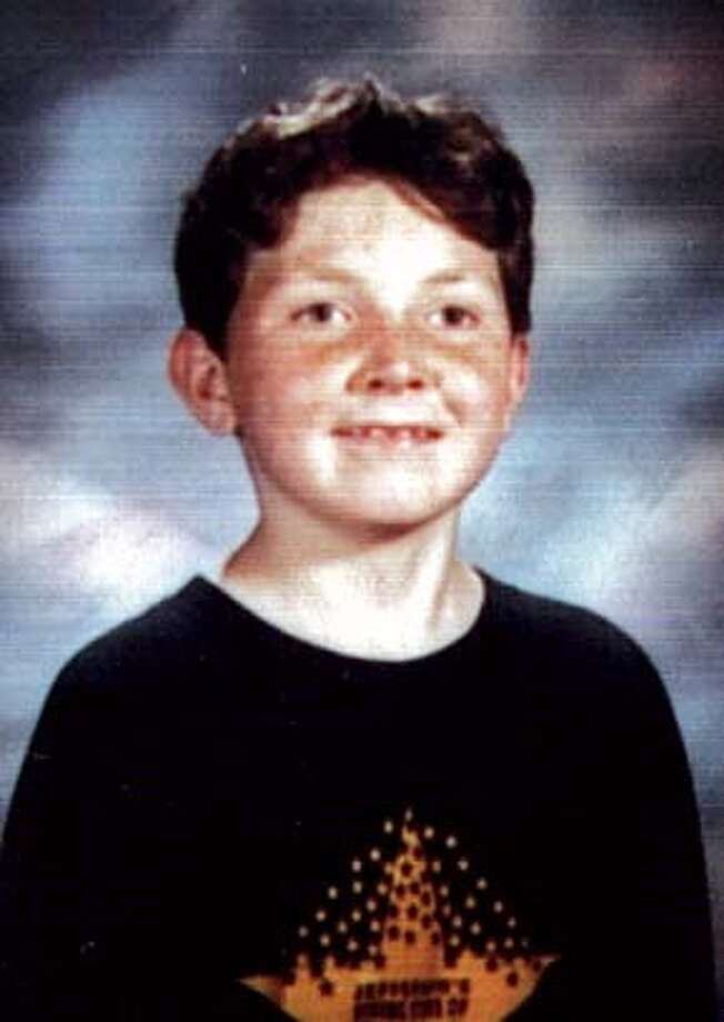 MANDATORY CREDIT FOR PHOTOG AND SF CHRONICLE/ -MAGS OUTDOGMAUL_125_MJM.jpg  A school portrait of Nicholas Scott Faibish who was a 6th grader at Roosevelt Middle School.  A 12-year-old boy, Nicholas Scott Faibish was mauled to death by his family's two pit bulls this afternoon in his apartment in San Francisco's Inner Sunset District as his mother screamed helplessly. The boy was attacked at 711 Lincoln Way across from Golden Gate Park about 3:15 p.m., police said. He was with his mother and two siblings when the 80-pound dogs -- a male named Rex and a female named Ella -- attacked him. Photo: Michael Maloney