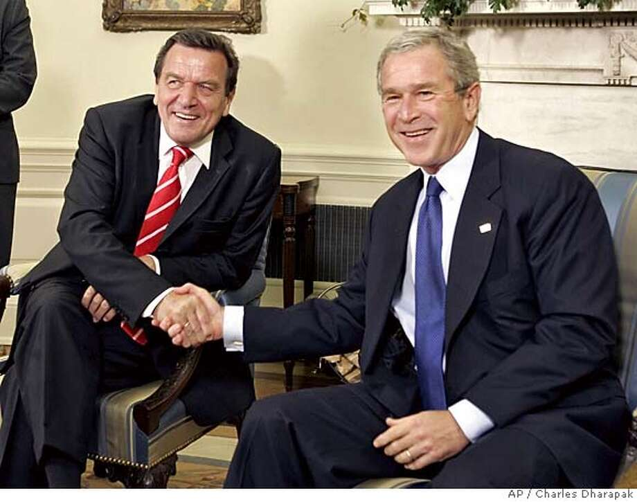 German Chancellor Gerhard Schroeder, left, meets with President Bush in the Oval Office of the White House, Monday, June 27, 2005, in Washington. Schroeder is meeting with Bush in a visit shortened by election-year pressure and overshadowed by the possibility Germany will have a new, more pro-American leader this fall. (AP Photo/Charles Dharapak) Photo: CHARLES DHARAPAK