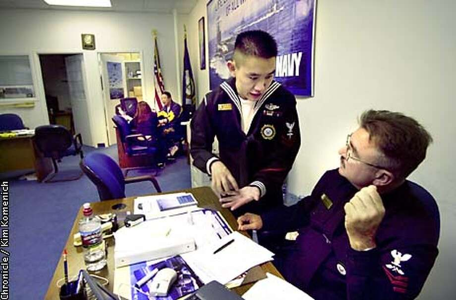 Petty Officer FIrst Class Hadrian Wei (left) discusses recruiting methods with Petty Officer Second Class France Borka during a lullin the action.  We visit the Navy offices at the Daly City Armed Forces Recruitment Center where we find a young woman in the process of signing up. Unfortunately, she doesn't want her face showing. SAN FRANCISCO CHRONICLE PHOTO BY KIM KOMENICH Photo: KIM KOMENICH