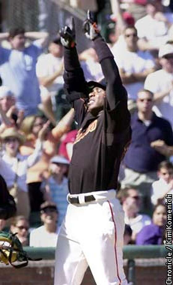 Giants vs. A's at SBC Park. The first day game since the war started. Barry Bonds celebrates a home run in the 5th.  SAN FRANCISCO CHRONICLE PHOTO BY KIM KOMENICH Photo: KIM KOMENICH