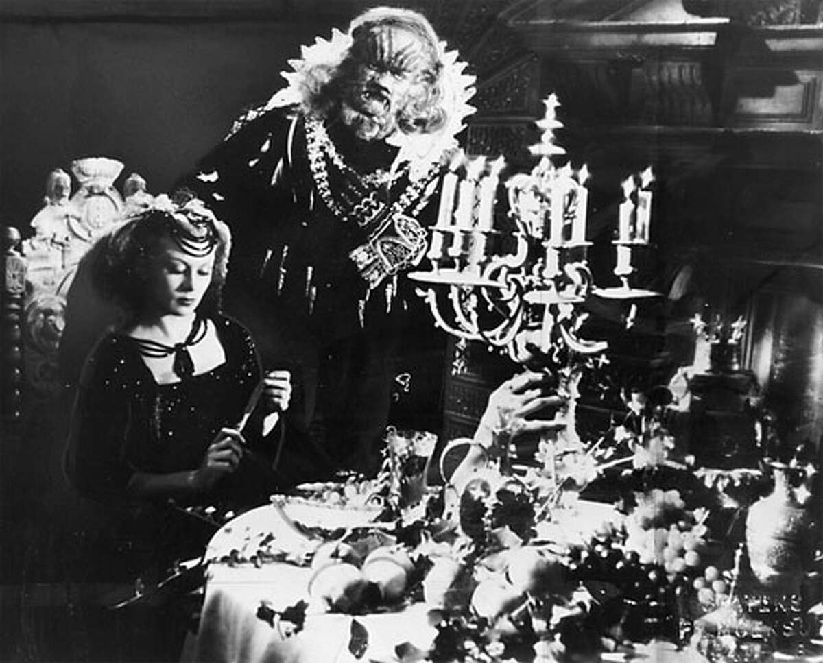 HOME08B_HO Josette Day as Beauty and Jean Marais as The Beast in Jean Cocteau's 1946 film BEAUTY AND THE BEAST (LA BELLE ET LA BETE).