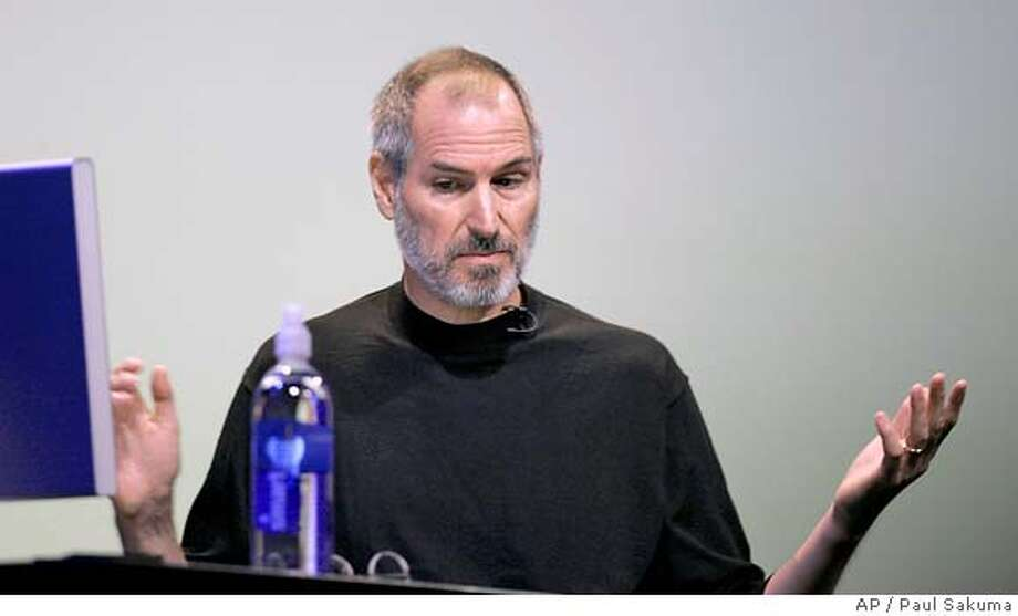Apple Computer CEO Steve Jobs gestures during his keynote at Apple Worldwide Developer Conference in San Francisco, Monday, Aug. 7, 2006. Apple Computer on Friday reiterated that its mishandling of past employee stock options will cause it to miss a regulatory deadline for filing its latest quarterly results as the iconic maker of iPod music players and Macintosh computers digs into its accounting troubles. (AP Photo/Paul Sakuma)  Ran on: 08-27-2006  Apple Computer CEO Steve Jobs received one stock-option grant that is now being reviewed by the Cupertino company. Photo: PAUL SAKUMA