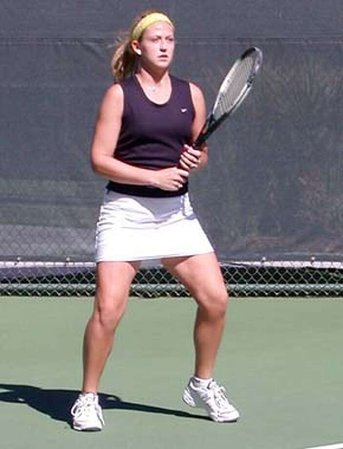 THIS IS A HANDOUT IMAGE. PLEASE VERIFY RIGHTS. USF2-C-03NOV02-SP-HO Michelle Duncan - USF tennis player action shot
