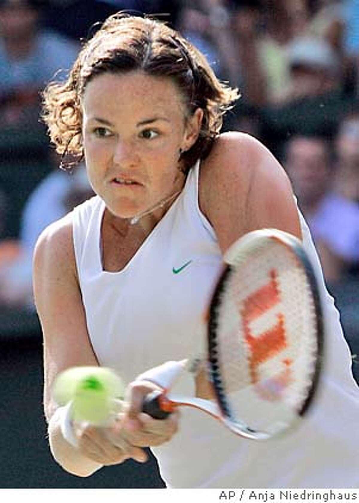 Lindsay Davenport, of the USA, returns to Kim Clijsters, of Belgium, on Centre Court at Wimbledon Monday, June 27, 2005. (AP Photo/ Anja Niedringhaus)