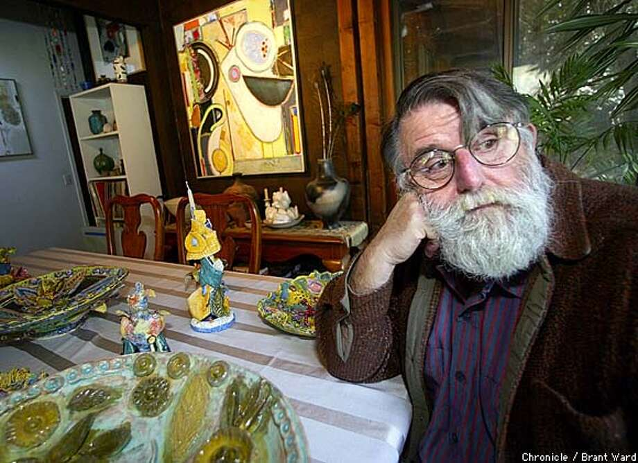Harley sits at the table of his Russian River home surrounded by some of his ceramic creations. The artist does superbly detailed stamps from imaginary countries. By Brant Ward/Chronicle Photo: BRANT WARD
