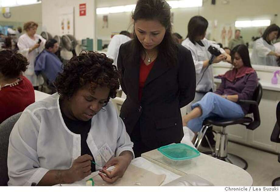 cosmetology_169_ls.JPG  LaDonna Christian (left) works on a nail design while Director/President Colleen Nguyen watches over at the San Francisco College of Cosmetology.  The San Francisco College of Cosmetology on Wednesday, November 15, 2006. Photo by Lea Suzuki/The San Francisco Chronicle  Photo taken on 11/15/06, in San Francisco, CA. **(themselves) cq. Ran on: 01-04-2007  LaDonna Christian works on a nail design while San Francisco College of Cosmetology Director Colleen Nguyen observes. Photo: Lea Suzuki