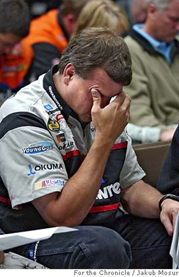 NASCARChurch27_05_JMM.JPG  Crew chief for car #29, Todd Berrier prays as Tim Griffin, chaplain with Motor Racing Outreach, holds a Christian service before a NASCAR race at the Infineon Raceway in Sonoma on Sunday June 26, 2005. Event on 6/26/05 in Sonoma. JAKUB MOSUR / The Chronicle MANDATORY CREDIT FOR PHOTOG AND SF CHRONICLE/ -MAGS OUT Photo: JAKUB MOSUR