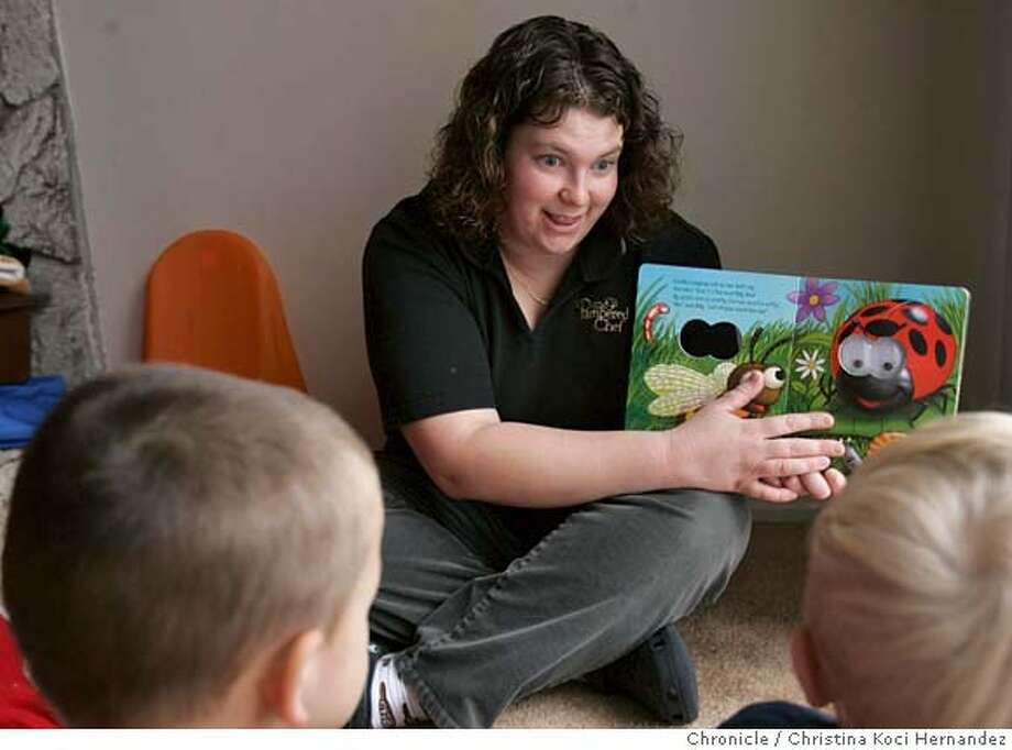 Egbers reads a book to the kids in her daycare before she puts them down for a nap. (Children to remianed unidentified.)Jenni Egbers, 30, who is a family child care provider in Concord who stays open 24 hours.5  .(CHRISTINA KOCI HERNANDEZ/CHRONICLE) CHRONICLE Photos by CHRISTINA KOCI HERNANDEZ Photo: CHRISTINA KOCI HERNANEZ/CHRONICL
