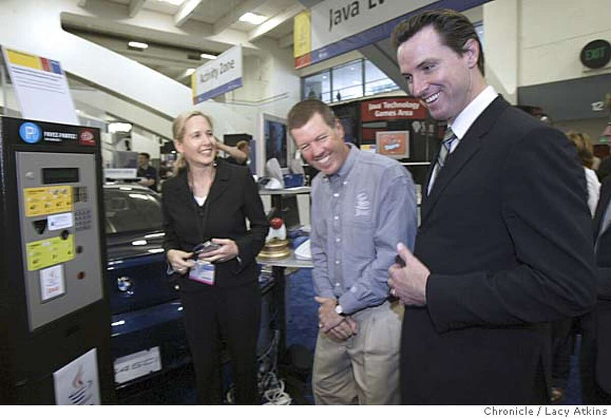 Sun Microsystems Chairman and CEO Scott McNealy,center meets with San Francisco Mayor Gavin Newsom and shows him the Java One gadgets,