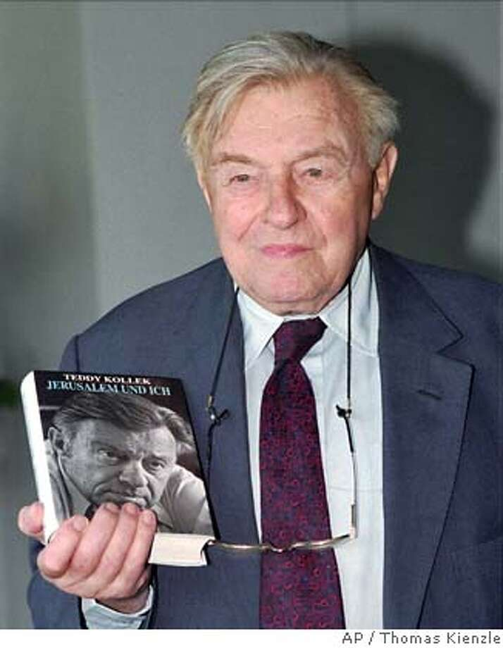 "** FILE ** Former Jerusalem mayor Teddy Kollek holds a copy of his book ""Jerusalem and me"" in Stuttgart in this Sept. 28, 1995 file photo. Kollek who was mayor of the holy city for 28 years died Tuesday Jan. 2, 2007, at the age of 95. (AP Photo/Thomas Kienzle) FILE PHOTO TAKEN ON SEPTEMBER 1995 Photo: THOMAS KIENZLE"