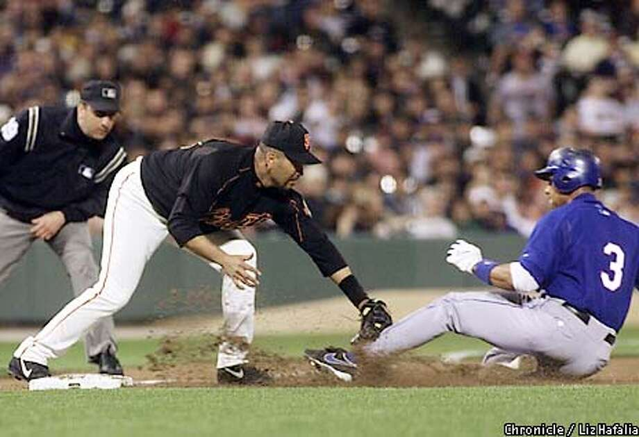Double play at the top of the third inning at third and home base. Giants' Edgardo Alfonzo tags out Rangers' Alex Rodriguez. (PHOTOGRAPHED BY LIZ HAFALIA/THE SAN FRANCISCO CHRONICLE) Photo: LIZ HAFALIA