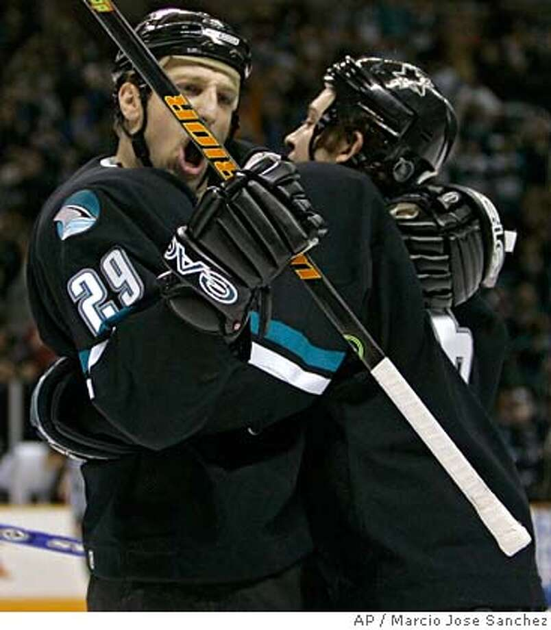San Jose Sharks' Ryan Clowe, left, is hugged by teammate Josh Gorges after Clowe's goal against the Detroit Red Wings in the second period of an NHL hockey game in San Jose, Calif., Thursday, Jan. 4, 2007.(AP Photo/Marcio Jose Sanchez) Photo: Marcio Jose Sanchez