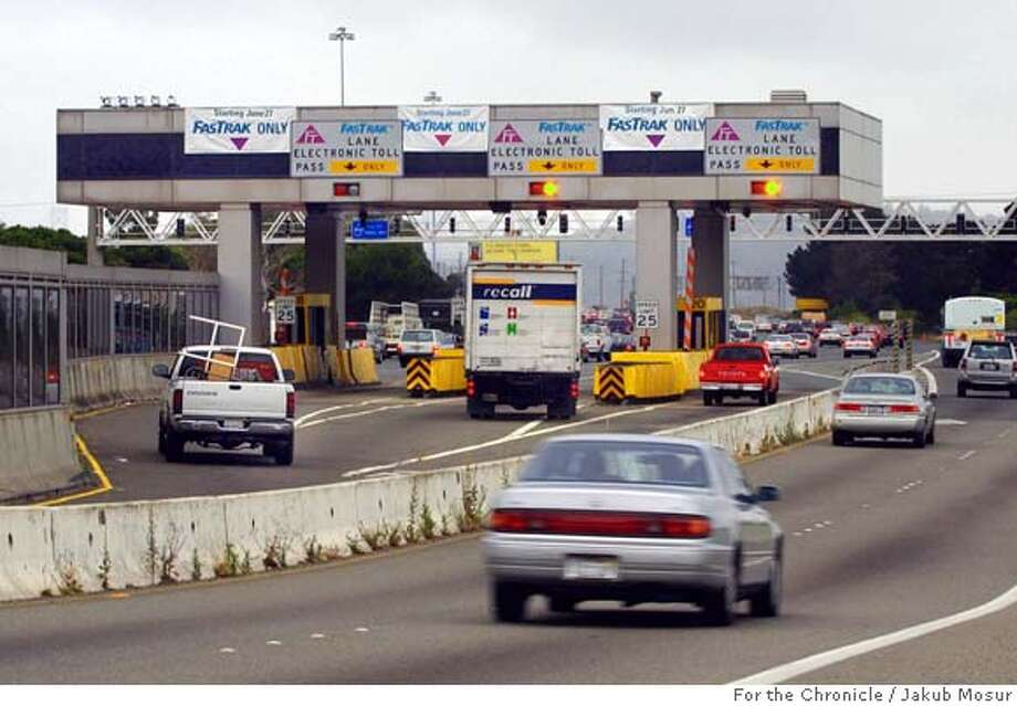 Commuters drive through the three new FasTrak lanes opened today at the Bay Bridge toll plaza on Monday June 27, 2005. Event on 6/27/05 in Oakland. JAKUB MOSUR / The Chronicle Photo: JAKUB MOSUR