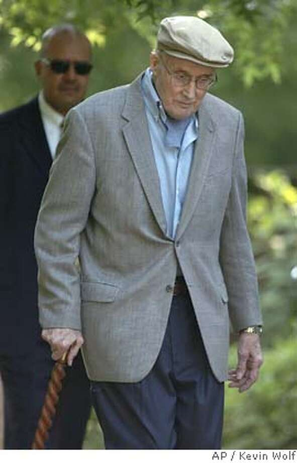 Chief Justice William Rehnquist leaves his home on Friday, June 24, 2005 in Arlington, Va. (AP Photo/Kevin Wolf) Ran on: 06-27-2005  Chief Justice William Rehnquist may step down today; he has cancer and has served 19 years. Photo: KEVIN WOLF