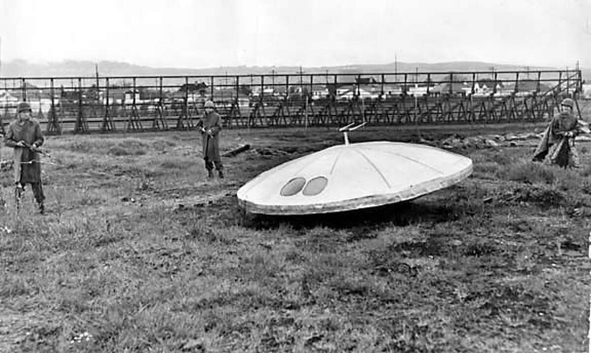 3 National Guardsmen and flying saucer in vacant lot near Bay Farm island. April 8, 1950 From the Chronicle Archive Library