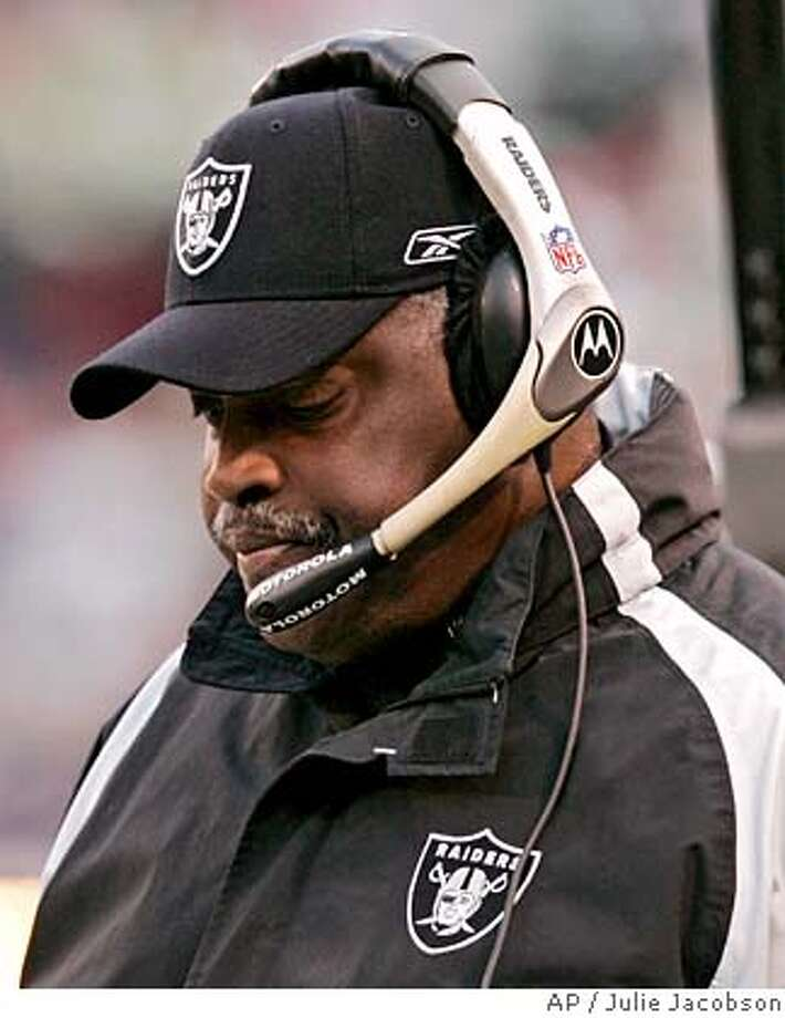 ** FILE ** Oakland Raiders coach Art Shell paces the sidelines in this file photo from an NFL football game against the New York Jets Sunday, Dec. 31, 2006, in East Rutherford, N.J. Shell's first season is now complete and the only direction the Raiders went was down. Oakland (2-14) set franchise records for losses and offensive ineptitude, while throwing in a good dose of turmoil and dissension in a season that was by far the worst in Al Davis' 44 years with the team. (AP Photo/Julie Jacobson) DEC. 31, 2006 FILE PHOTO EFE OUT Photo: Julie Jacobson