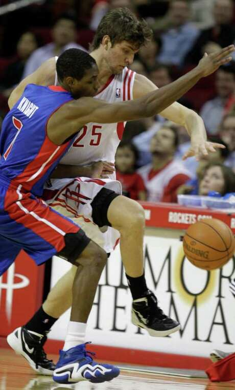Although his offense has turned heads, Rockets rookie Chandler Parsons (25) is playing defense like a veteran, here stealing the ball from the Pistons' Brandon Knight while skirting the sideline. Photo: Melissa Phillip / © 2011 Houston Chronicle