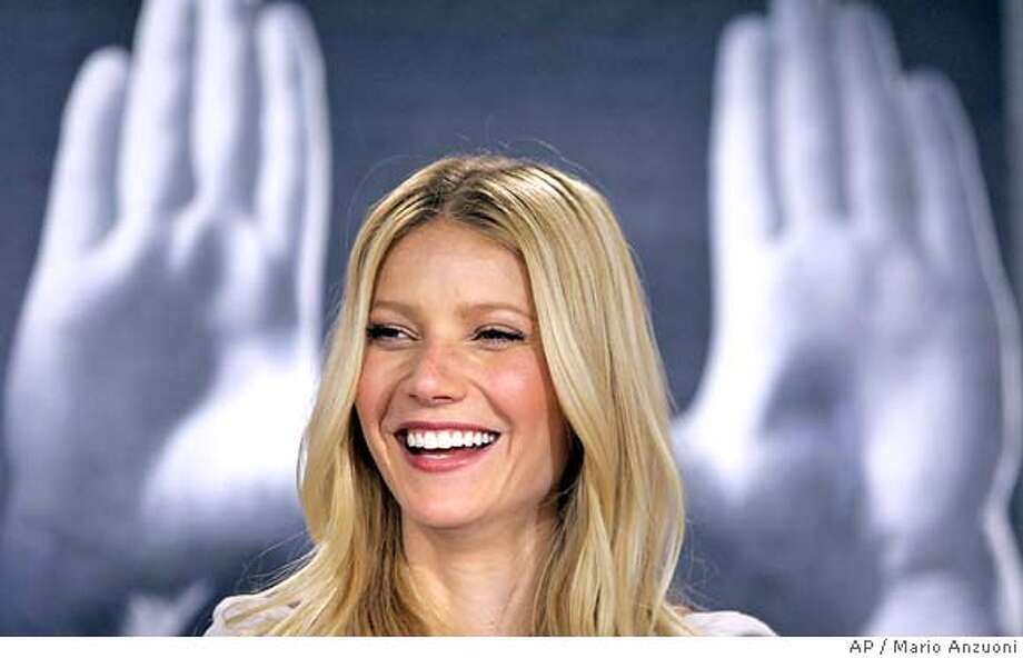 "Actress Gwyneth Paltrow smiles at the news conference for the movie ""Proof"" at the 30th Toronto International Film Festival in Toronto in this September 12, 2005 file photo. Paltrow and her musician husband Chris Martin are expecting their second child, celebrity television program The Insider reported on January 13, 2006. The show said Paltrow, who has a daughter with Martin, was at a screening of her movie, ""Proof,"" in Los Angeles on Thursday when actor Lou Diamond Phillips introduced her to the audience as a ""pregnant woman"" and asked her how far along she was. Picture taken September 12, 2005. REUTERS/Mario Anzuoni/Files 0 Photo: MARIO ANZUONI"