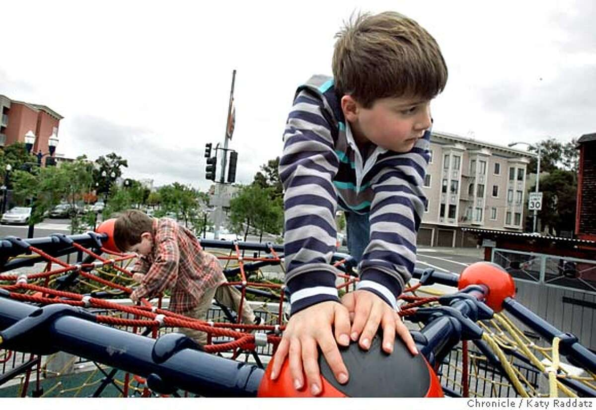 OCTAVIA28_087_RAD.jpg SHOWN: L to R: Eric Billy, 5 and-a-half, from Danville; Ryan Billy, age 8, from Danville, both climb atop the cool climbing web on Octavia Bl. at Fell St. The boys are in San Francisco to see