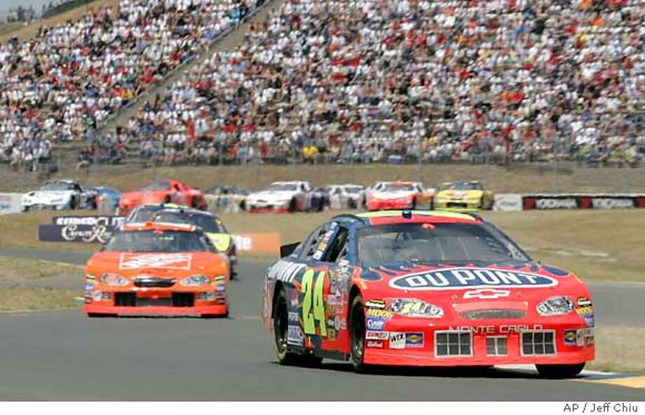 Jeff Gordon, foreground, leads at Infineon Raceway in the Dodge/Save Mart 350 NASCAR Nextel Cup in Sonoma, Calif., Sunday, June 26, 2005. Behind Gordon, at left, is Tony Stewart. (AP Photo/Jeff Chiu) Ran on: 06-27-2005  Tony Stewart (left) chases Jeff Gordon before catching and passing him en route to his first win in 30 starts and the 20th of his NASCAR career, the fourth on a road course. Ran on: 06-27-2005  Tony Stewart (left) chases Jeff Gordon before catching and passing him en route to his first win in 30 starts and the 20th of his NASCAR career, the fourth on a road course. Photo: JEFF CHIU