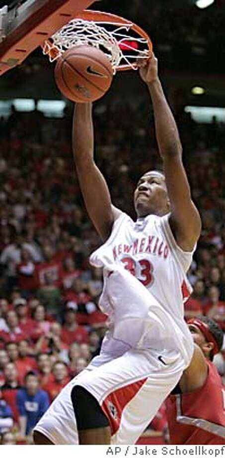 ** ADVANCE FOR WEEKEND EDITIONS, JUNE 25-26 -- FILE -- ** New Mexico's Danny Granger dunks in the second half against UNLV at The Pit in Albuquerque, N.M., Saturday, Jan. 29, 2005. New Mexico won 62-58. (AP Photo/Jake Schoellkopf) Photo: JAKE SCHOELLKOPF
