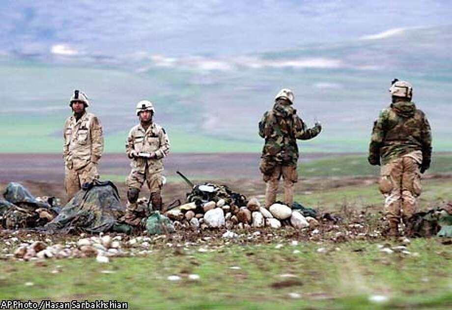 Paratroopers of the U.S. Army's 173rd Airborne prepare their equipment at the Harir airfield, 45 miles northeast of the Kurdish city of Irbil, Thursday March 27, 2003. Denied rights to invade by land from Turkey, the U.S. military instead parachuted about 1,000 Army troops into Kurdish-held northern Iraq in a nighttime operation that opened another front against Saddam Hussein's regime. (AP Photo / Hasan Sarbakhshian) Photo: HASAN SARBAKHSHIAN