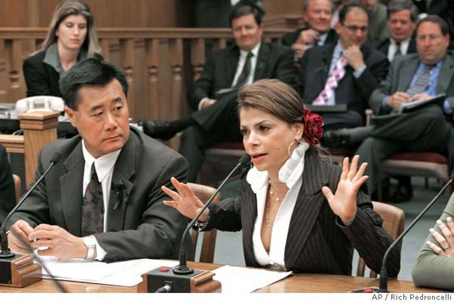 Entertainer Paula Abdul, right, urges lawmakers to approve a measure that would require stronger cleanliness standards for nail salons, during a committee hearing at the Capitol in Sacramento, Calif., Monday, June 27, 2005. Abdul told members of the Senate Business, Professions and Economic Develoment Committee, how she had gotten an infection while getting a manicure from a Studio City nail salon in 2004. If passed by the Legislature, the measure by Assemblyman Leland Yee, D-San Francisco, left, wouldstrengthen cleanliness standards and require nail salons to post conspicous notices when disciplinary action is taken against them. (AP Photo/Rich Pedroncelli) Photo: RICH PEDRONCELLI