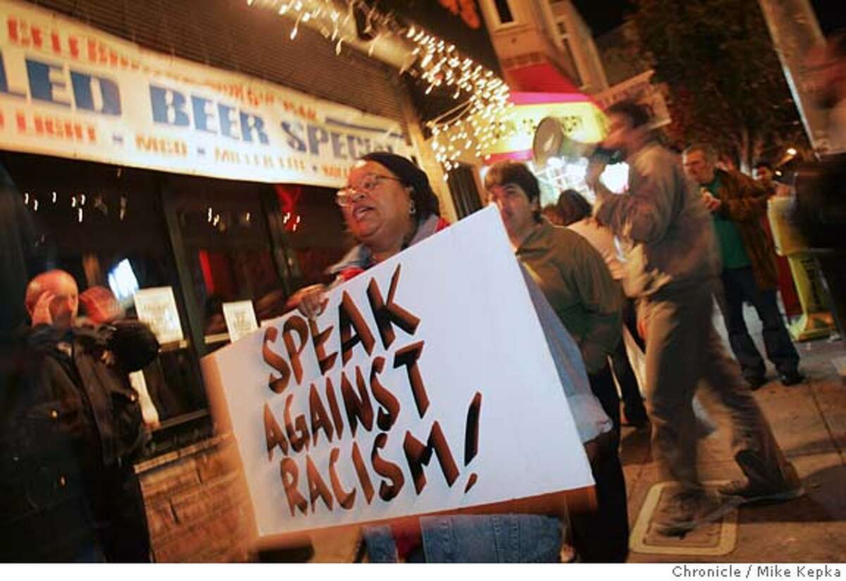 Gwen Craig of San Fracisco protests boycotts SFBadlands on Saturday night. A civil rights group called And Castro for All has started a boycott and conducts weekly Saturday night protest of SF Badlands, a bar in the Castro. The group claims bar owner Les Natali is a racist and back up their assertions with a report from the SF Human Rights Commission that found Natali discriminated against some people of color who tried to enter his bar 6/17/05 Mike Kepka / The Chronicle