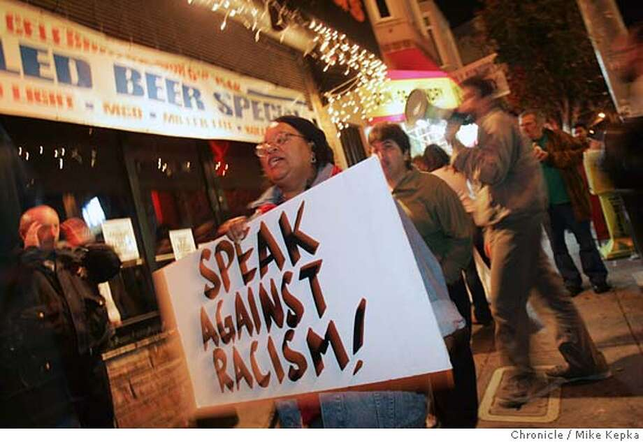 Gwen Craig of San Fracisco protests boycotts SFBadlands on Saturday night.  A civil rights group called And Castro for All has started a boycott and conducts weekly Saturday night protest of SF Badlands, a bar in the Castro. The group claims bar owner Les Natali is a racist and back up their assertions with a report from the SF Human Rights Commission that found Natali discriminated against some people of color who tried to enter his bar 6/17/05 Mike Kepka / The Chronicle Photo: Mike Kepka
