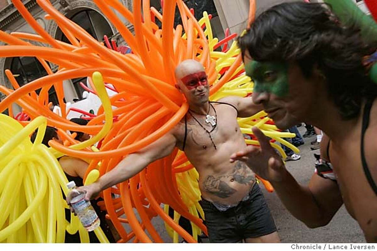 PRIDE27_832.jpg_ Fernando Gonzales from Mexico (with water in hand) was one the the Balloon Magic men that took part in the 35th annual Gay Pride parade Sunday. By Lance Iversen/San Francisco Chronicle MANDATORY CREDIT PHOTOG AND SAN FRANCISCO CHRONICLE.