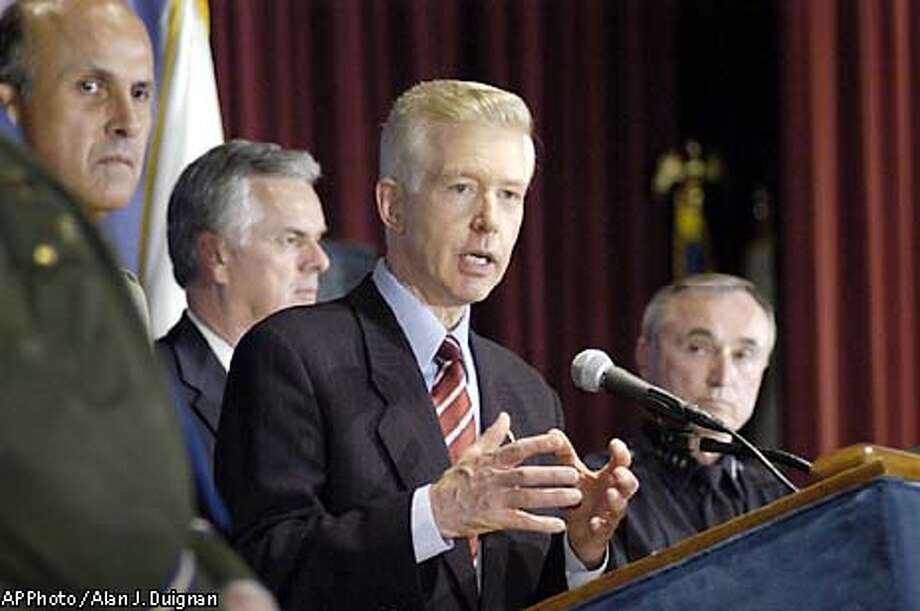 California Gov. Gray Davis announces the security measures the state is taking with local governments in the wake of a war with Iraq, Thursday, March 20, 2003, at the Ronald Reagan State Building in Los Angeles. Also shown are, from left, Los Angeles County Sheriff Lee Baca, Los Angeles Mayor Jim Hahn, Davis and Los Angeles Police Chief William Bratton. (AP Photo / Alan J. Duignan) Photo: ALAN J. DUIGNAN