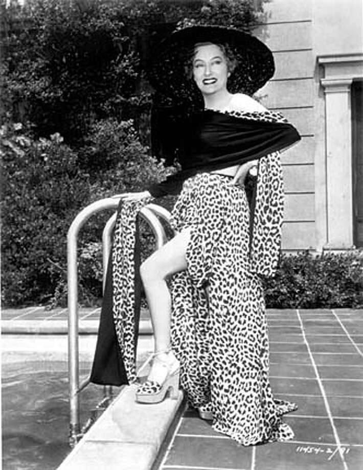 """POP27B-27MAR03-DD-HO Gloria Swanson in """"Sunset Boulevard,"""" 1950 Leopard skirt included in exhibition Courtesy of the Academy of Motion Picture Arts and Sciences. Clothing included in the exhibitionIconic to Ironic: Fashioning California Identity March 15-Sept. 21, 2003, Oakland Museum of California. HANDOUT PHOTO/VERIFY RIGHTS AND USEAGE Photo: HANDOUT"""