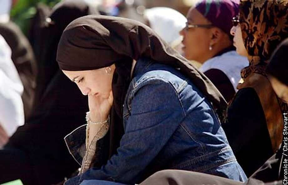 Maya Fallaha (cq) of Foster City listens to a sermon by the Imam Hanaza Jusuf (cq) Friday, March 28, 2003 during a prayer for peace in the SF Civic Center. Muslims were joined by people of other religious affiliations as about two hundred people listened to spokepersons for various faiths before being lead in prayer by the Imam, executive director of the Zaytuna Institute. CHRIS STEWART/SAN FRANCISCO CHRONICLE Photo: CHRIS STEWART