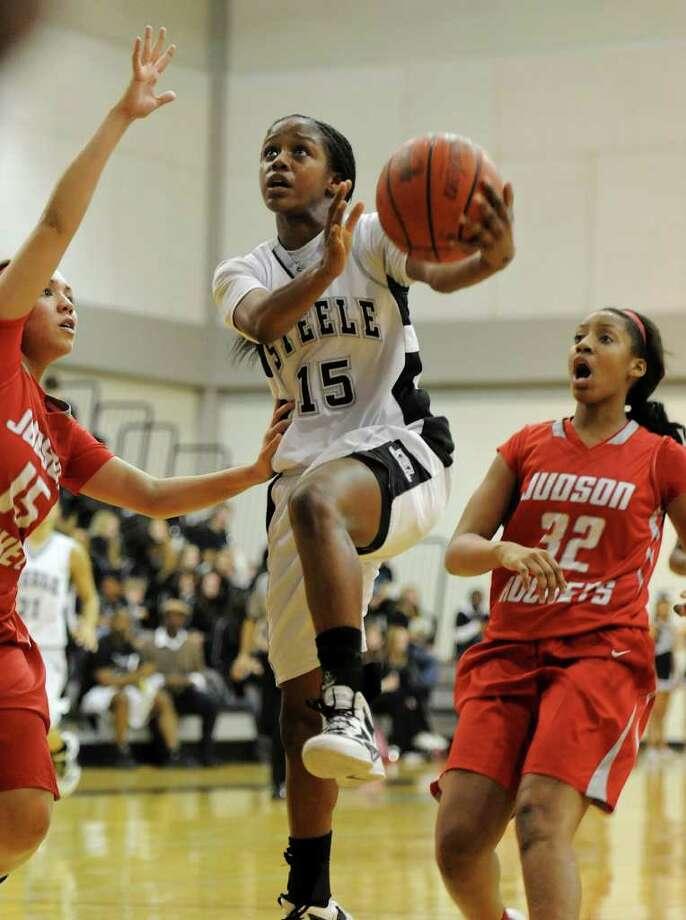 Steele's Kyra Lambert (15) maneuvers past a couple of Judson defenders during a District 25-5A matchup Friday. Photo: Express-News