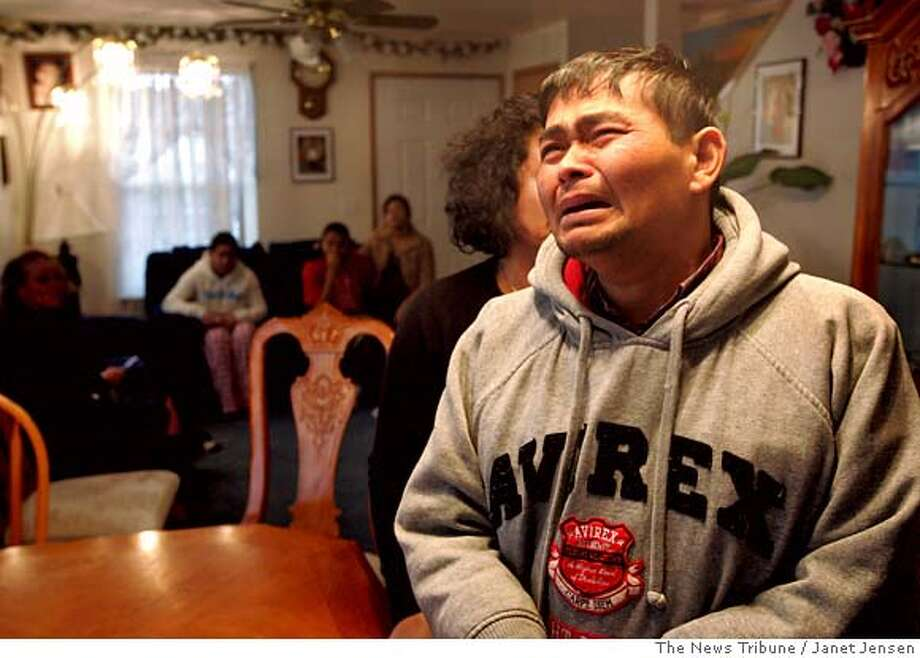 Rorth Kok mourns the loss of his son Samnang Kok in the company of friends and family at his eastside Tacoma, Wash., home, Wednesday, Jan. 3, 2007. Samnang Kok was shot to death in a high school hallway Wednesday as classes were about to resume after the winter break, and police arrested a fellow student found wandering a neighborhood a few blocks away, authorities said. (AP Photo/The News Tribune, Janet Jensen) Photo: Janet Jensen