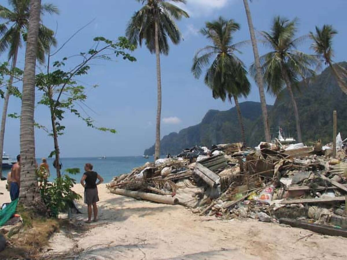 TRAVEL THAILAND -- A pile of debris pulled by volunteer divers off the ocean floor just off the beach on the island of Phi Phil Don, which sustained severe damage from the tsunami.