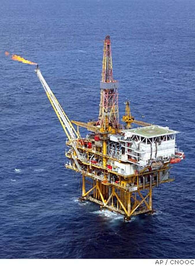 A Sept. 23, 2003 aerial photo shows the offshore platform of the Pinghu Oil and Gas Field, part of China National Offshore Oil Corporation (CNOOC) Ltd. facilities in eastern China Sea near Shanghai.China's third-largest oil producer made an unsolicited US$18.5 billion (euro15.3 billion) bid Thursday, June 23, 2005 for U.S. oil and gas company Unocal Corp., setting up a possible contest with rival bidder Chevron Corp. (AP Photo) ** ONLINE OUT, CHINA OUT **