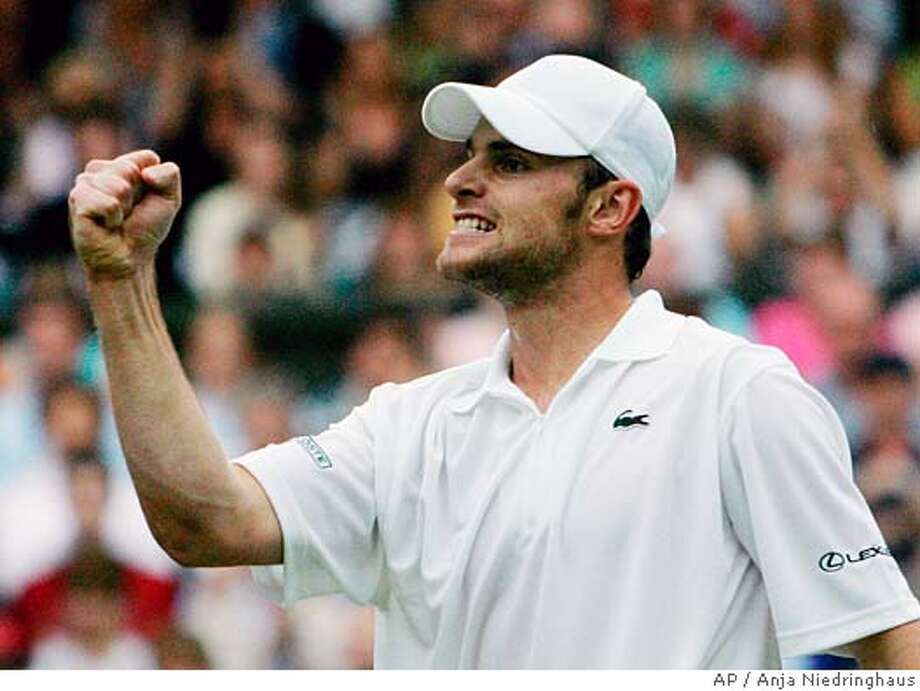 Andy Roddick, of the USA, celebrates after defeating Daniele Bracciali, of Italy, on Centre Court at Wimbledon Friday, June 24, 2005. Roddick won 7-5, 6-3, 6-7 (3), 6-4. (AP Photo/Anja Niedringhaus) Photo: ANJA NIEDRINGHAUS