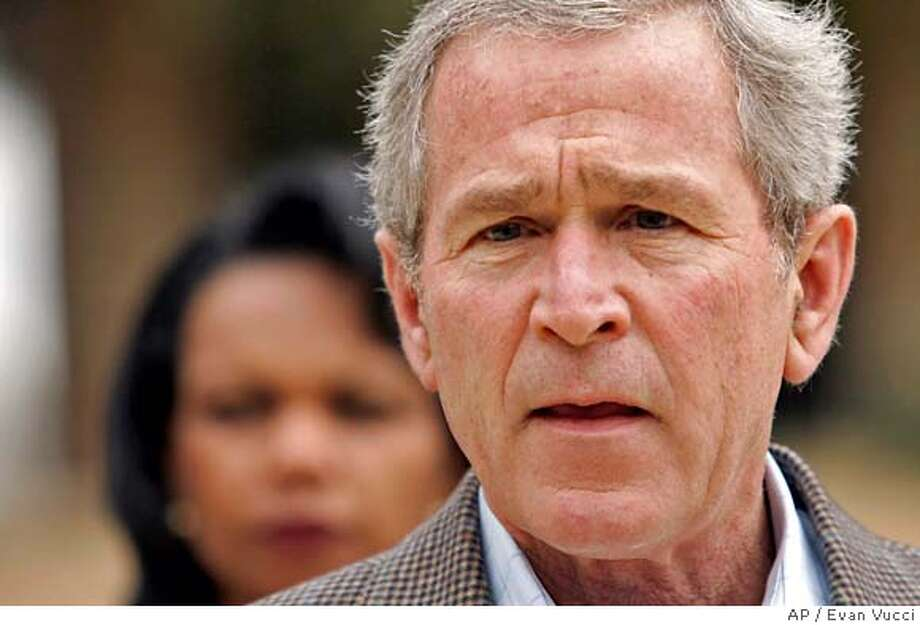 "President Bush pauses during a statement about a meeting with his national security team Thursday, Dec. 28, 2006 in Crawford, Texas. At left is Secretary of State Condoleezza Rice. Bush said he has moved one step closer to devising a new Iraq strategy but will seek more advice before settling on a final plan. ""We're making good progress,"" Bush said (AP Photo/Evan Vucci) Photo: EVAN VUCCI"