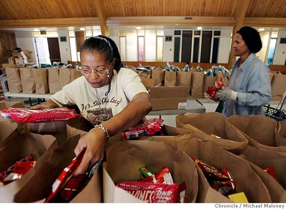 Alma Ferguson (left) is a volunteer for a program at the Allen Temple Baptist Church in Oakland that distributes grocery bags full of food to seniors. Ferguson is also a participant in the program. Photo by Michael Maloney / San Francisco Chronicle Photo: Michael Maloney