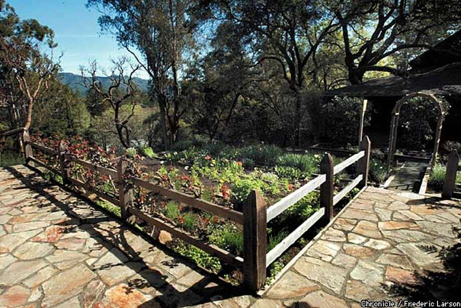 JOYCE26d-C-12MAR03-HM-FRL: Garden Walks at the Schramsberg Vineyard who's owner used blueprint of old gardens to restore the garden. Old Victorian and its surrounds; overall shot of the vineyards; 130-year-old olive alley; cellars ; Portrait of Jamie D