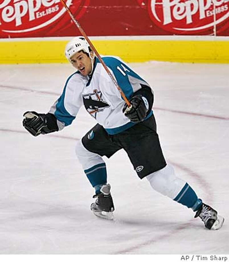 San Jose Sharks' Jonathan Cheechoo celebrates after scoring a goal during the first period of a hockey game against the Dallas Stars Sunday night, Dec. 31, 2006, in Dallas. (AP Photo/Tim Sharp) Photo: Tim Sharp