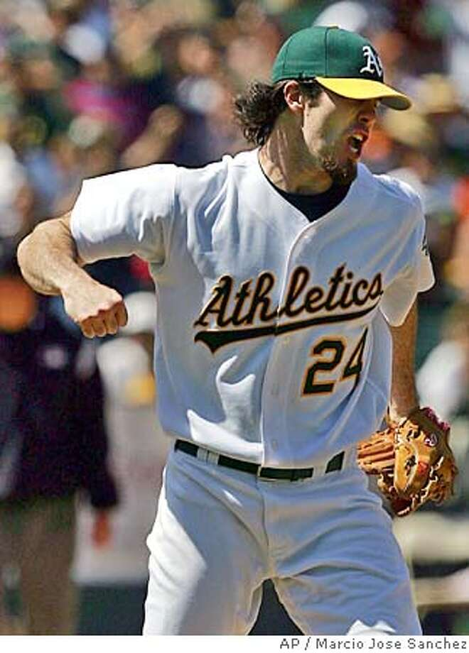 Oakland Athletics starter Dan Haren celebrates after striking out the San Francisco Giants' Todd Linden to end the game on Saturday, June 25, 2005 in Oakland, Calif. Oakland won 6-3. (AP Photo/Marcio Jose Sanchez) Photo: MARCIO JOSE SANCHEZ